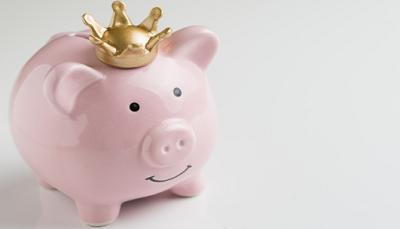 Piggy bank wearing a crown
